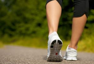 bigstock-Female-Walking-Outdoors-In-Run-48089690